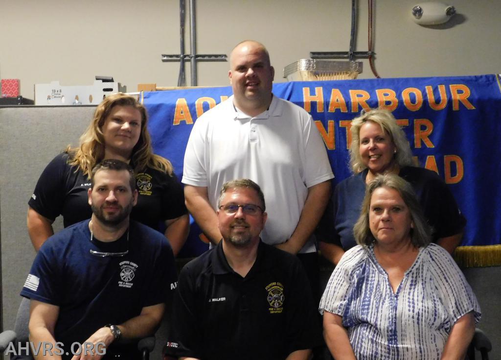 Squad officers: Sean Lunn, Jeff Walker, Roxanne Dunn,  back row: Angela Wilhelm, James Boswell, Kathy Webster behind the camera: Chris Schoon